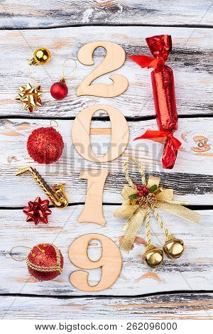 Wooden Number 2019 And Christmas Ornaments. Wooden Digit 2019 Decorated With Red Christmas Balls, Bo