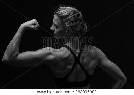 Fit Woman With Shaped Muscles On Her Back In Artistic Conversion