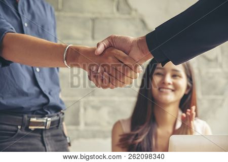 Business People Handshake (shaking Hands)with Partnership After Success Deal And Complete Agreement,