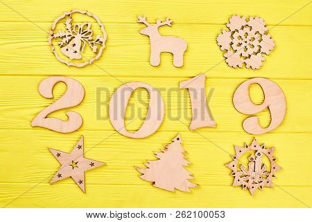 Wooden Digit 2019 And New Year Silhouettes. Cut Out Wooden Number 2019 And Christmas Wooden Ornament
