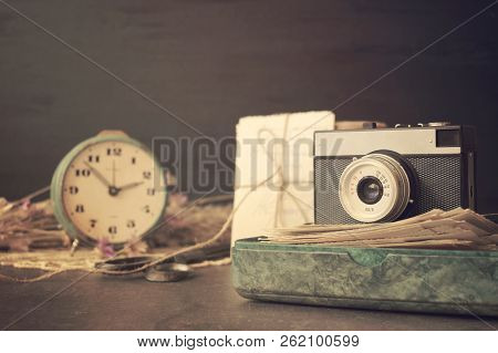 Retro Old Camera With Pile Of Photos, Letters, Malachite Box And Antique Watches On Wooden Backgroun