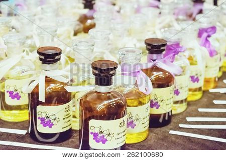 Kiev, Ukraine - 19 September, 2018: Many Bottle Of Various Woman Perfumes In Glass Bottles With Bow