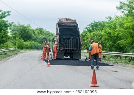 Kropivnitskiy, Ukraine – 27 May, 2018: Road Repair Concept. Road Construction Equipment And Workers