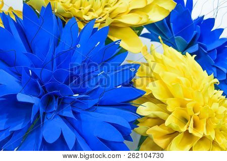 Large Giant Paper Flowers. Big Blue And Yellow Dahlias Made From Paper. Pastel Paper Background Patt