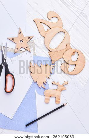 New Year Handicraft Wooden Decorations. Cut Out Wooden Number 2019, Christmas Wooden Ornaments, Pape