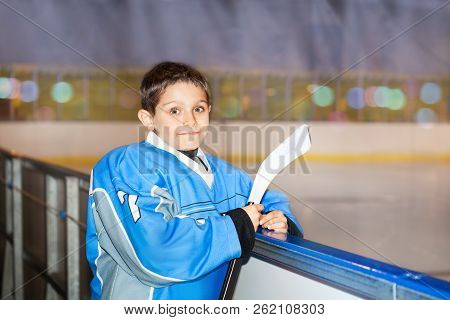 Little Ice Hockey Player Waiting To Enter The Game