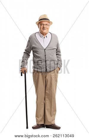 Full length portrait of a senior man standing with a cane isolated on white background