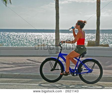 Girl On Bike Drinking Water  2