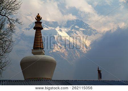 poster of view of stupa and Annapurna 2 II, round Annapurna circuit trekking trail, Nepal