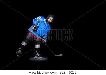 Ice Hockey Player With Stick Over Black Background