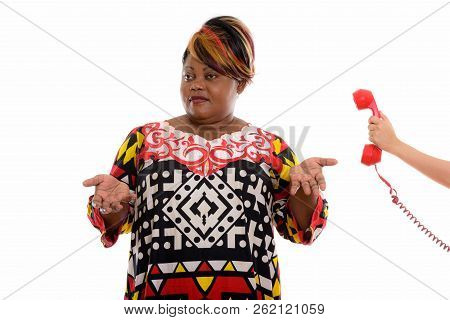 Studio Shot Of Fat Black African Woman Thinking While Shrugging
