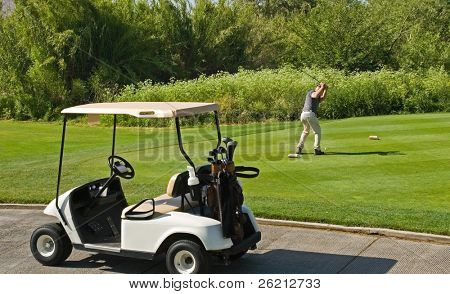 Golf course action and players hitting the greens