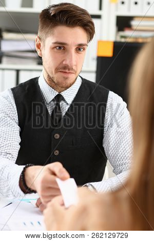 Male Hand In Suit Give Blank Calling Card To Female Visitor Portrait. White Collar Partners Company