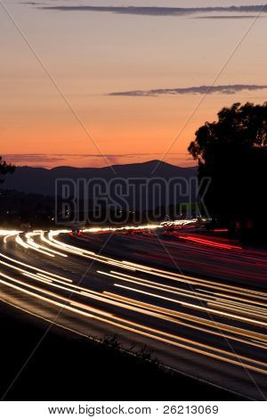 Rush hour traffic at twilight on a busy and fast moving freeway or highway poster