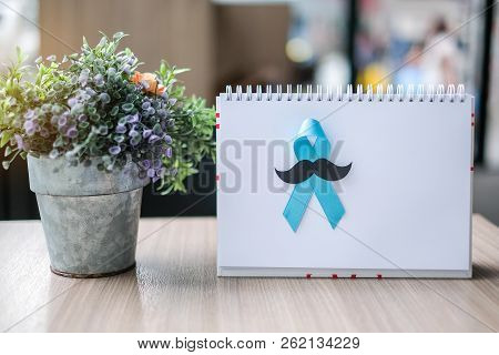 Prostate Cancer Awareness Month (november), Light Blue Ribbon On White Paper For Supporting People L