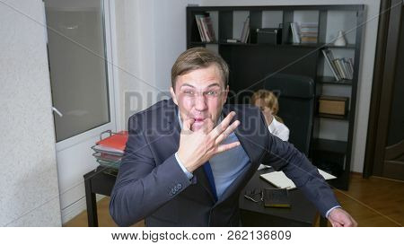 Humor, Irony. A Man In The Office Whistles, Alerting Workers. Business Concept.