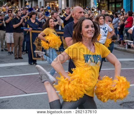 Morgantown, Wv - 5 October 2018: Homecoming Parade Down Main Street Of Morgantown With Alumni Cheer