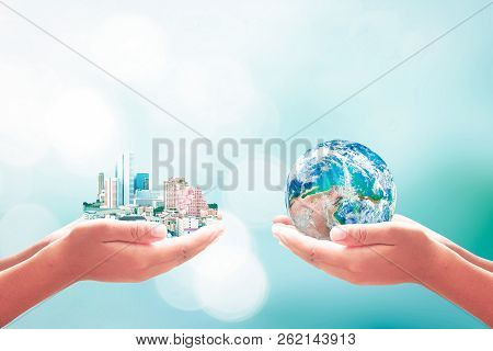 World Environment Day Concept: Two Human Handing Big City And Earth Globe Over Blurred Blue Nature B