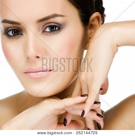 beauty portrait of attractive young caucasian  woman brunette isolated on white studio shot face skin hands eyes perfect looking at camera makeup spa cosmetic