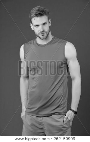 Confident Sportsman. Man Handsome Sports Clothing Violet Background. Athlete Sportsman Confident Put