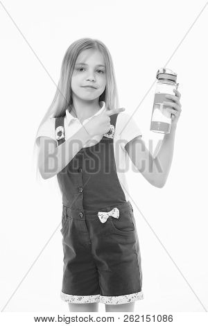Girl On Smiling Face Posing With Bottle Of Water, Isolated On White Background. Kid Girl With Long H