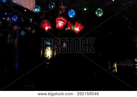 Bright Colored Lamp Bulbs Seen Through A Retail Window At Night