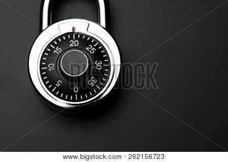 Code Numbers On Combination Pad Lock On Dark Black Background With Copy Space, Locking Device In Whi