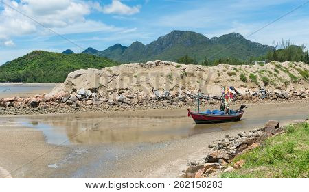 Red Fishing Boat On Beach And Green Hill And Sea And Reef Or Rock. Fisherman Boat Or Fishing Boat Fo