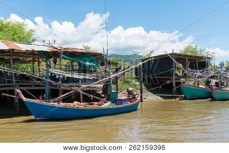 Fishing Village And Fishing Boat At Khao Dang Village. Old Home And Fishing Boat And Blue Sky And Cl