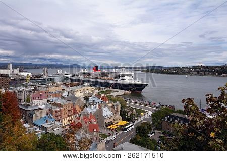 Autumn View Of Quebec City And The St. Lawrence River With Cruise Ships.