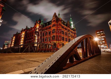Old Speicherstadt In Hamburg Illuminated At Night. Arch Bridge And Historical Buildings. Warehouse D