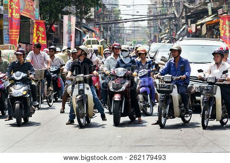 Ho Chi Minh City - February 4: People On Motorbikes On A Busy Street On February 4, 2012 In Ho Chi M