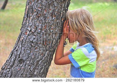 Little Kid Playing Hide And Seek