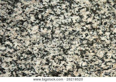 Closeup of naturally split igneous granite showing crystalline structure for a background?