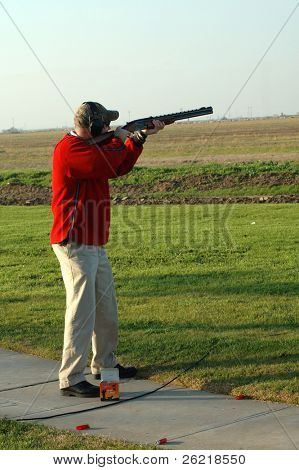 A left-handed shotgun shooter on the trap range