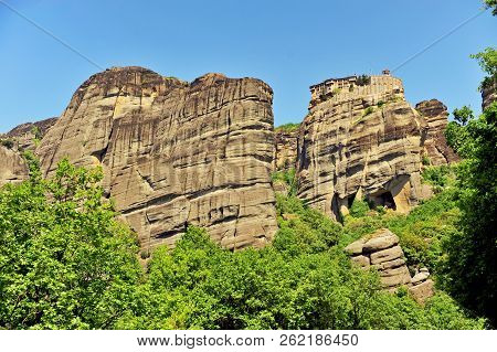 Scenic View Of Natural Cliffs And Old Monastery