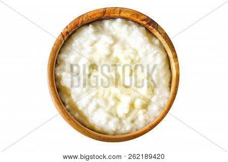 Rice Porrige. Rice Milk Porridge Isolated On White Background. Top View. Porridge In A Wooden Bowl.