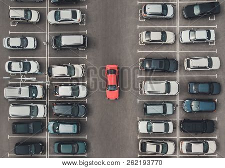 Top View Of The Crowded Parking Lot With Quadcopter Or Drone. Original Bright Automobile Among The G