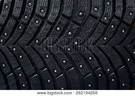 Wheel tire seamless pattern. A close up of a tire protector and studs. Winter tyre texture. Realistic illustration. Black rubber, studs and protector background poster