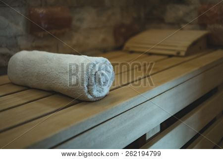 An Individual Cotton Towel On A Wooden Bench Prepared For A Sauna Client. Comfortable Classical Stea