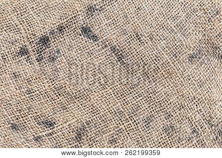 Burlap Texture Or Burlap Background. The Texture Of The Burlap Closeup. Natural Textured Burlap Sack