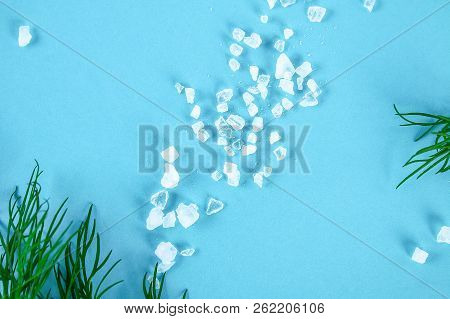 Crystals Of Large Sea Salt And Dill On A Blue Table. Background For Advertising Salt. Table Salty. S