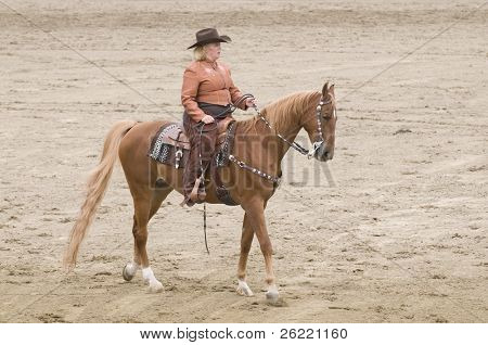 woman riding western at a horse show