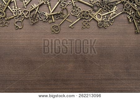 Many Different Vintage Keys. Vintage Keys Concept On Wooden Background. Vintage Keys With Copy Space