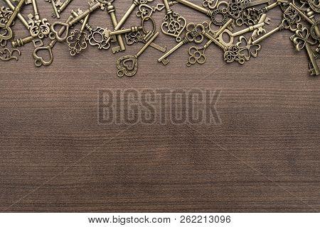 Many Different Vintage Keys. Vintage Keys Concept On Wooden Background. Vintage Keys With Copy Space