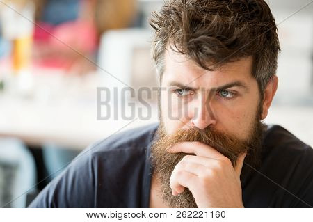 Beard masculinity attribute. Man brutal bearded hipster thoughtful face defocused background. Macho with beard and mustache look confident brutal. Beard represent masculinity. Think and realize poster