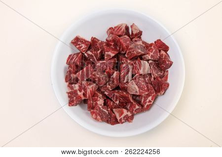 Fresh raw beef meat in bowl with white background