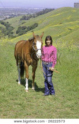 pretty woman walking her horse