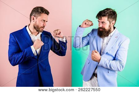 Business Partners Competitors Or Office Colleagues In Suits With Tense Faces Ready To Fight. Hostile