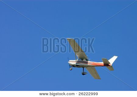 small old generic general aviation hi-wing aircraft overhead